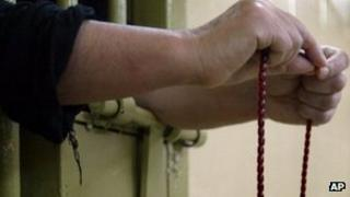 An Iraqi inmate with prayer beads at Baghdad's prison. File photo