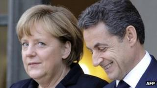 German Chancellor Angela Merkel (left) with French President Nicolas Sarkozy in Paris, 5 December 2011
