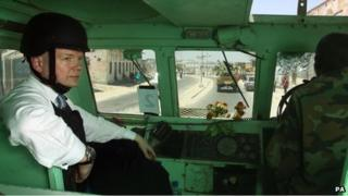 British Foreign Secretary William Hague drives through Mogadishu, Somalia, in a Kasspir armoured vehicle driven by Amisom troops in a visit to the war-torn country
