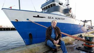Greg Brooks in front of his boat, Sea Hunter