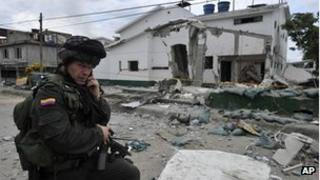 Police officer in front of wrecked police station in Villa Rica. 2 Feb 2012