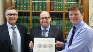 L-R, Robbie Marsland, UK Director of IFAW, Detective Inspector Brian Stuart, Environment Minister Richard Benyon MP