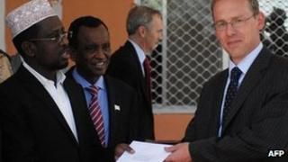 "Somali President Sheik Sharif Sheik Ahmed (L) receives diplomatic credentials from the Britain""s new ambassador to Somalia Matt Baugh (R) at the Hilltop presidential palace in Mogadishu, Somalia on February 2, 2012"