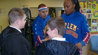 Flip Atkins (left) and Blenda Rodriquez speak to two pupils