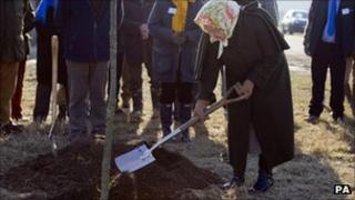 The Queen plants a tree on the Sandringham estate