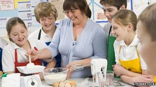 Teacher showing children how to cook