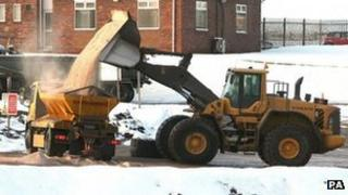A gritter is filled with salt during freezing cold weather in the UK