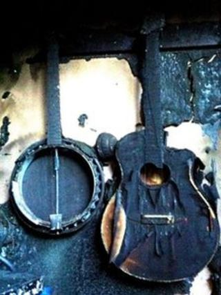 Fire-damaged instruments belonging to New Model Army