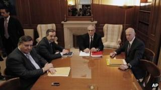 The leaders of the three parties backing Greece's coalition government, George Papandreou, right, Giorgos Karatzaferis, left, and Antonis Samaras, 2nd left, meet with Prime Minister Lucas Papademos, 2nd from left, in Athens