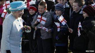 The Queen meeting children waving flags