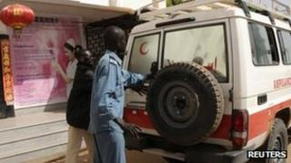 Police close the door of an ambulance carrying the body of a Chinese worker killed during a kidnapping, after he was handed over to Chinese Embassy representatives by a Sudanese Red Crescent representative and a Sudanese Foreign Ministry official at the Chinese-run Hawasha hospital in Khartoum
