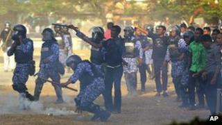 Police clash with the military during protests in the Maldives on 7 February 2012