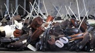 Handguns seized by police on the floor of the police armoury, Kingston, Jamaica. 7 Feb 2012