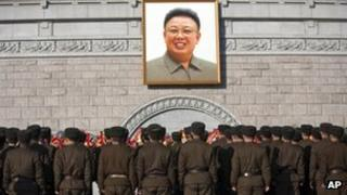 North Korean soldiers in front of a portrait of the late Kim Jong-il