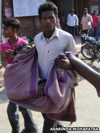 A victim of the toxic alcohol in Orissa being taken to hospital on 8 February 2011