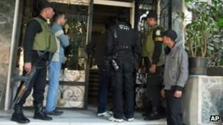 Egyptian soldiers stand guard in front of the offices of a non-governmental organisation in Cairo on 29 Dec 2011