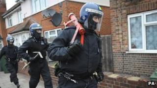 Officers during one of the raids