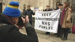 Campaigners against NHS Gloucestershire's plans arrive at the High Court in London