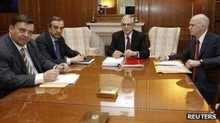 Greek party leaders, from left, George Karatzaferis, Antonis Samaras, Prime Minister Lucas Papademos and George Papandreou at the prime minister's office in Athens (8 Feb 2012)