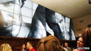 David Beckham's commercial for H&M plays during a break in the Super Bowl 5 February 2012