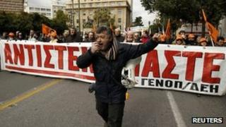 Members of Greece's public power corporation workers union (GENOP) march during a protest in Athens February 9