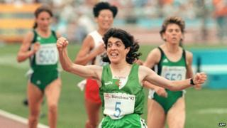 Hassiba Boulmerka raises a fist as she crosses the finishing line to win gold in the 1500m in Barcelona in 1992