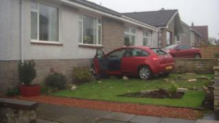 Crash into bungalow