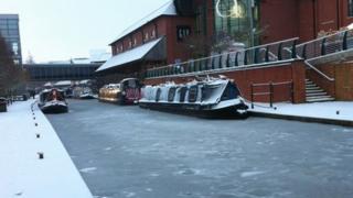 Frozen canal outside Castle Quay Shopping Centre in Banbury