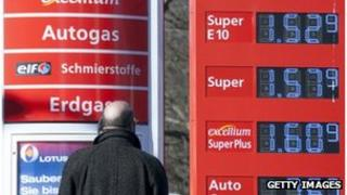 Man looks at prices at a German petrol station