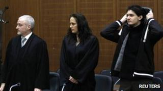 Arid Uka (R) with legal team in court in Frankfurt (January 9, 2012)