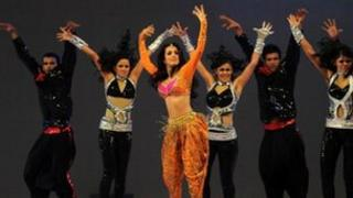 Indian film actress Malika Arora (3rd L) dances during in the inaugural ceremony of the Bangladesh Premier League (BPL) at Sher-e-Bangla National Cricket Stadium in Dhaka on February 9 , 2012