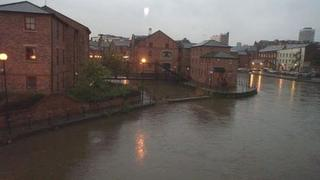A full River Aire in Leeds city centre