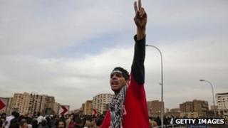 A protester shout slogans during a demonstration against Egypt's military rulers