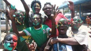 Zambian fans with painted faces celebrate their victory over Ivory Coast