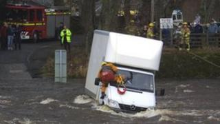 A van being rescued from Stanhope Ford in Weardale