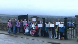 Protestors demonstrating against the use of a path at Llanbeblig graveyard