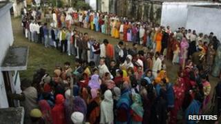 Voters line up at a polling booth in Uttar Pradesh.