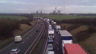 Queue of traffic on the A34 with Didcot power station in the background