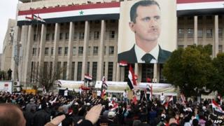 Supporters of President Bashar al-Assad attend a demonstration in central Damascus (15 February 2012)