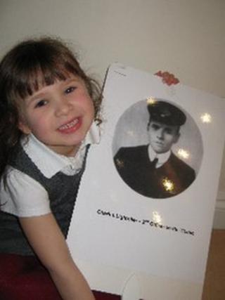 Schoolgirl holding placard of Charles Lightoller