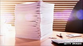 Pile of papers on office desk