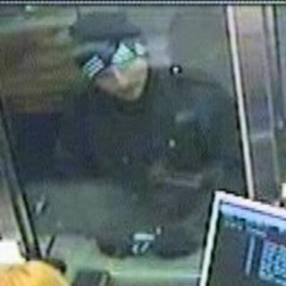 CCTV image of man police want to speak to about the bank robbery