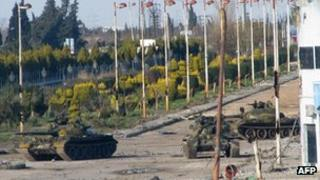 Three Syrian army tanks on a boulevard at the entrance to Baba Amr in Homs