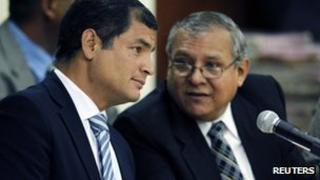 Rafael Correa (left) with his lawyer at the hearing at the National Court of Justice