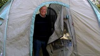 Swindon North Rotarian Terry Williams in a ShelterBox emergency tent