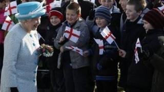 The Queen meeting children waving flags