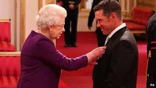 Lee Westwood receives his OBE from the Queen