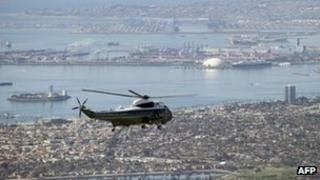 The White House helicopter Marine One with US President Barack Obama aboard flies over Long Beach, California, on Thursday