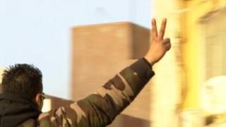 Man celebrates the anniversary of the uprising that overthrew Col Muammar Gaddafi in Benghazi, Libya