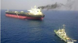The Napoli registered Italian merchant vessel Enrica Lexie (L) is anchored off the harbour in the southern Indian city of Kochi February 16, 2012